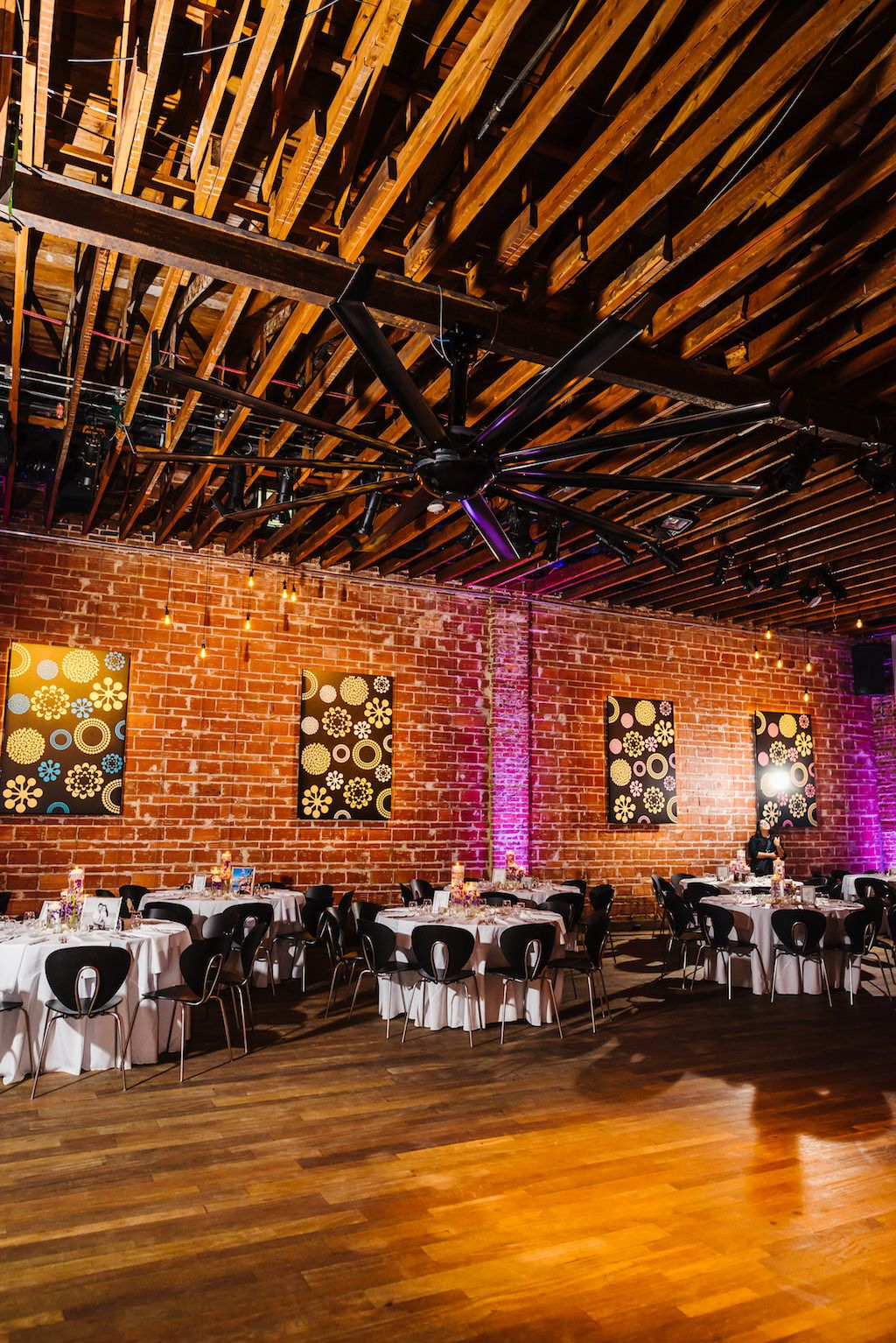 Downtown St Pete Historic Wedding Venue NOVA 535 Reception Decor with Modern Purple Uplighting on Exposed Brick - Whimsical St. Pete wedding at unique event venue NOVA 535