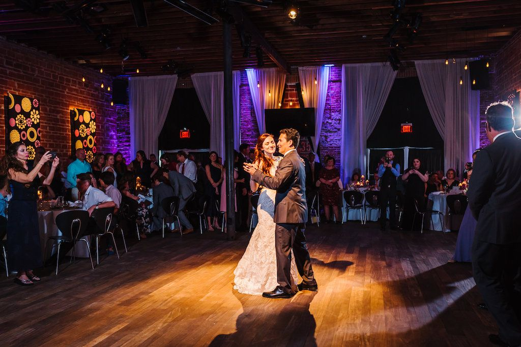First Dance Wedding Portrait in Downtown St Pete Historic Wedding Venue NOVA 535 Reception, with Modern Purple Uplighting on Exposed Brick - Whimsical St. Pete wedding at unique event venue NOVA 535