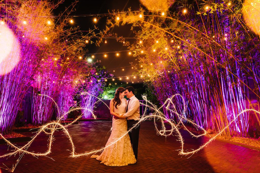 Nighttime Wedding Portrait with Sparklers in Historic Downtown St Pete Venue NOVA 535 Bamboo Garden with String Lights