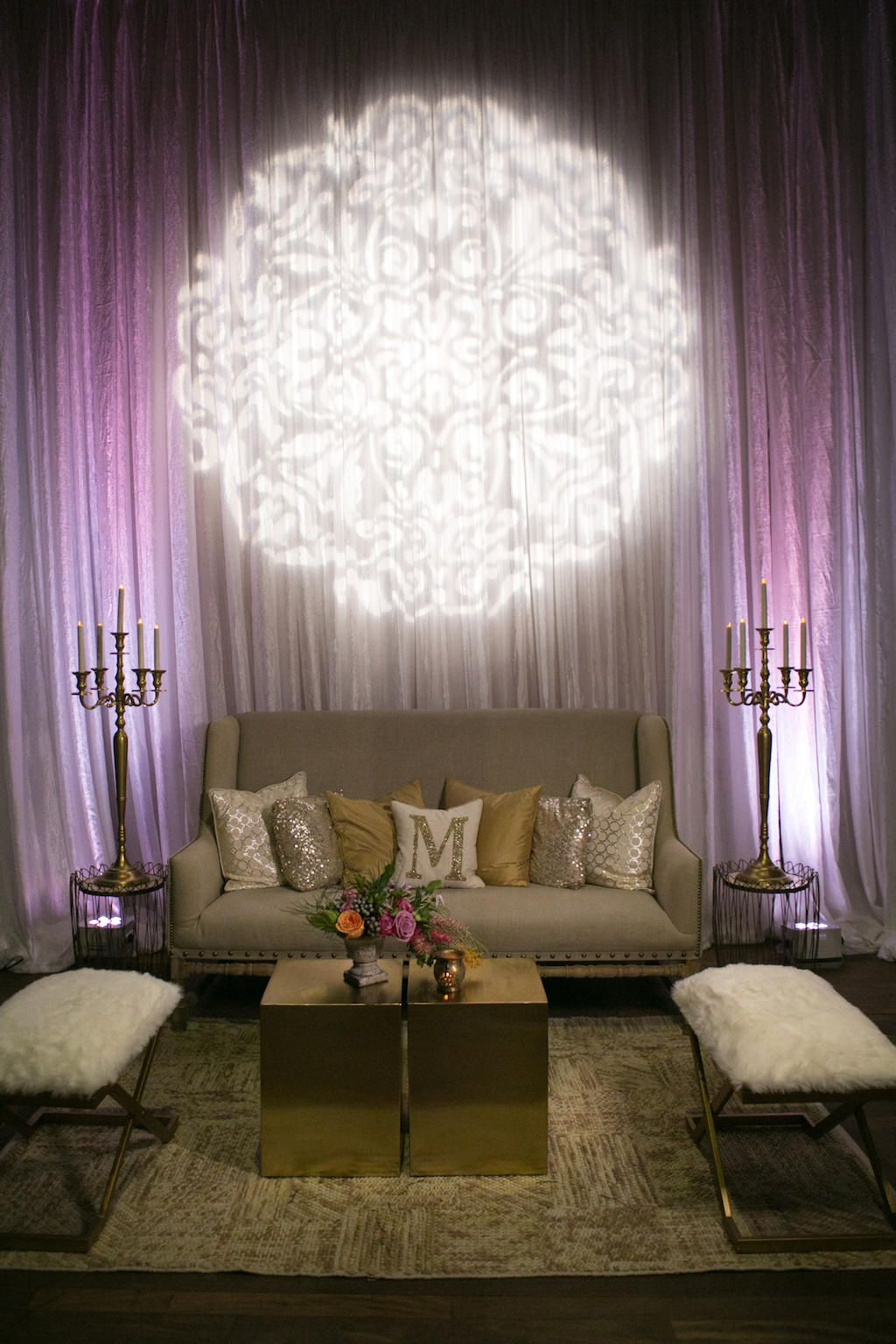 Stylish Wedding Lounge Decor with Modern Furnishings, Tropical Florals, and Purple Uplighting | Luxurious St. Pete Wedding Venue NOVA 535