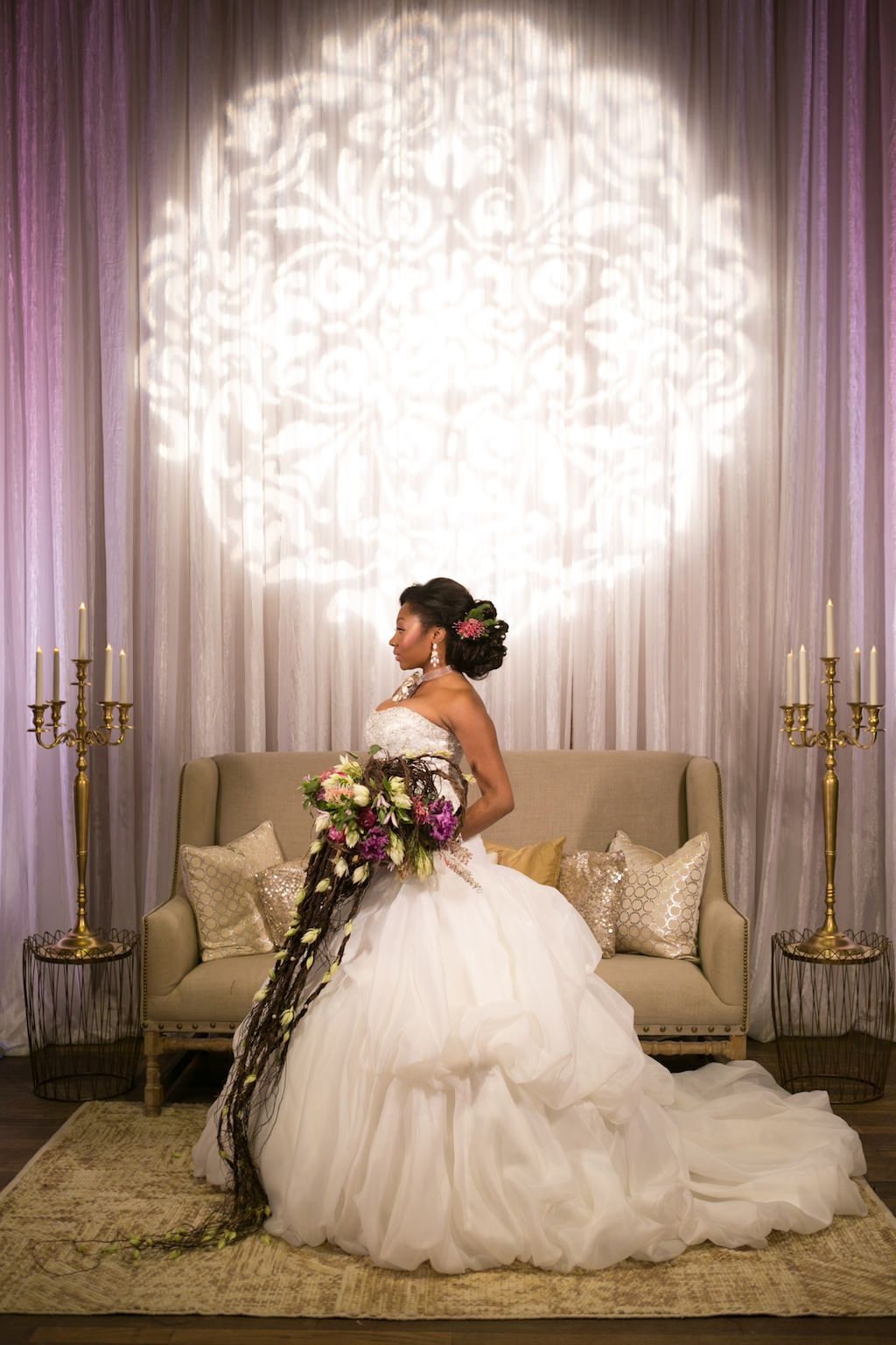 French Inspired Marie Antoinette Bridal Portrait with Cascading Natural Tropical Wedding Bouquet in Ballgown Wedding Dress, Candelabras and High Back Lounge Sofa and Light Projection | Luxurious St Pete Wedding at Unique Downtown Venue NOVA 535