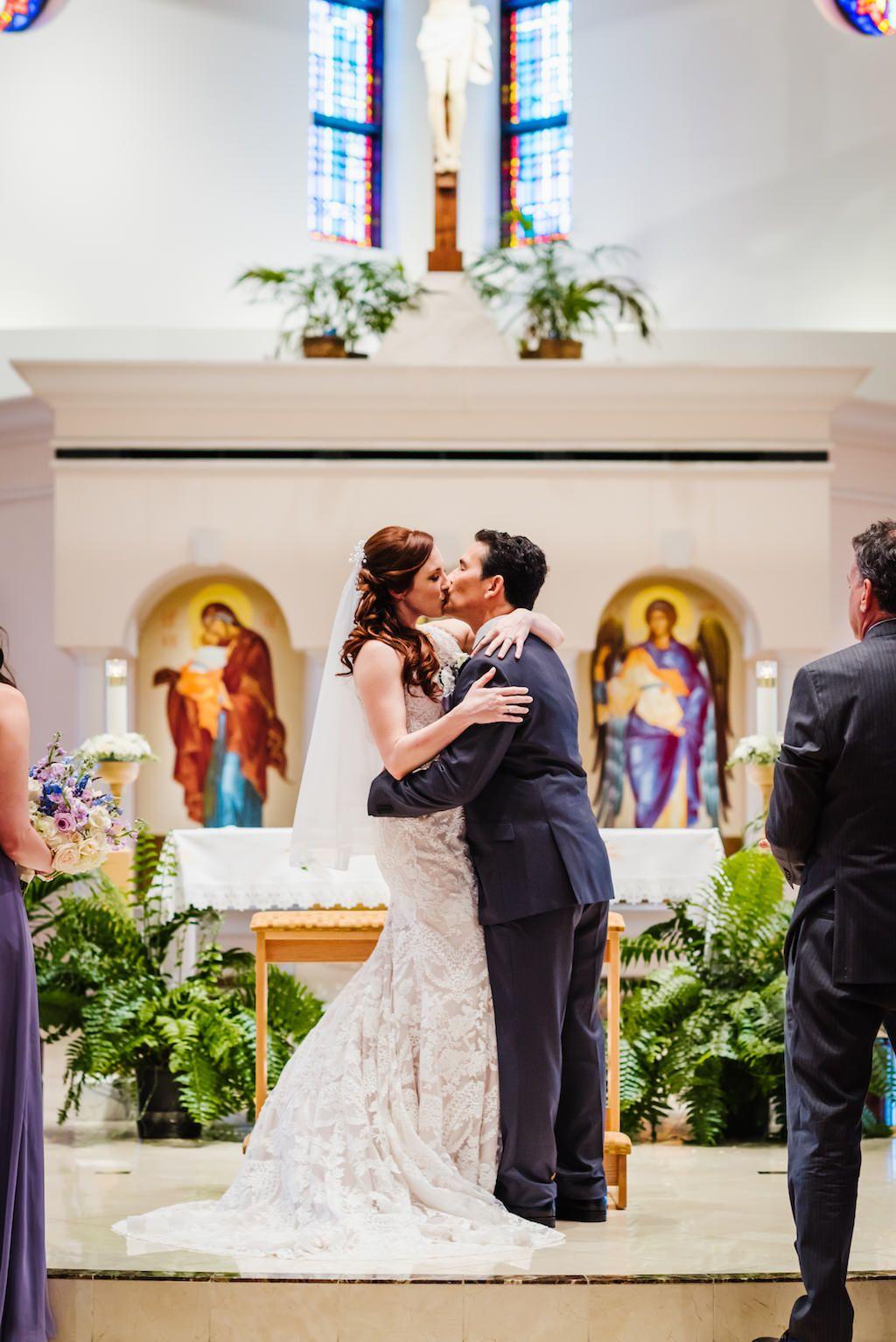 Traditional Church Ceremony First Kiss Wedding Portrait | St Pete Ceremony Venue St. Raphael's Catholic Church
