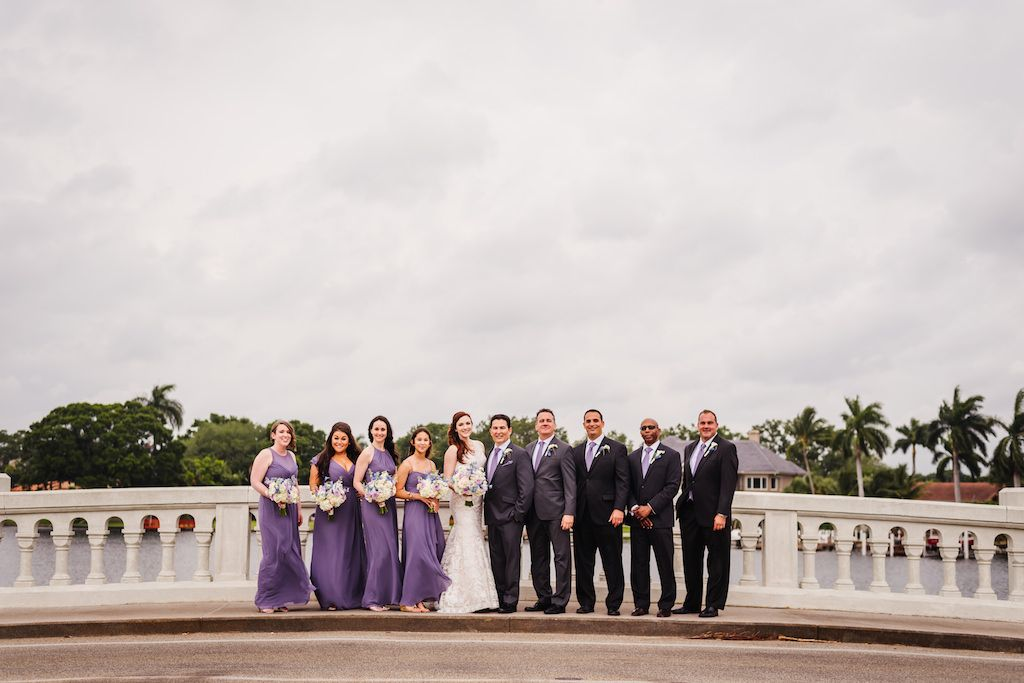 DTSP Waterfront Wedding Party Portrait, Bridesmaids in Dusty Purple Mismatched Dessy Dresses, Groomsmen in Black and Gray Suits with Pastel Purple Ties