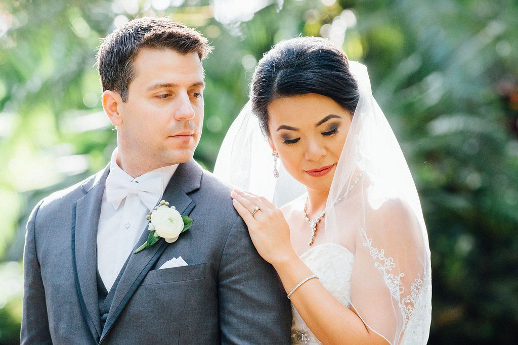 Outdoor Garden Wedding Portrait, Groom in Gray Tuxedo with White Bowtie and White Floral with Greenery Boutonniere
