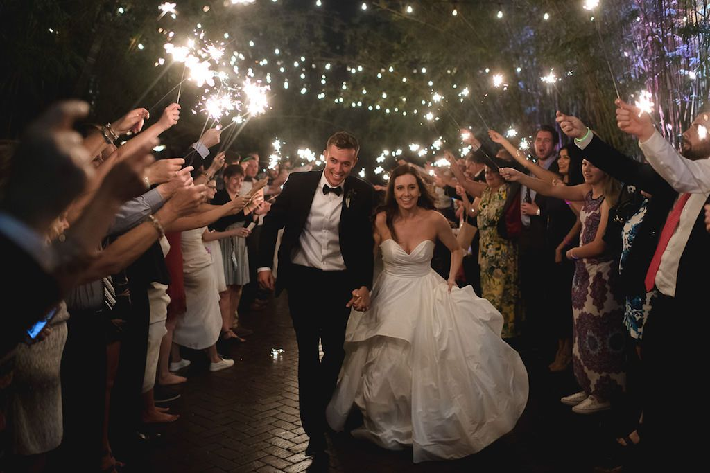 Outdoor Garden Sparkler Wedding Exit Portrait in Bamboo Courtyard with String Lights, Bride in Strapless Ballgown Layered Hayley Paige Dress | Downtown St Pete Wedding Venue NOVA 535 - St. Pete Wedding Reception