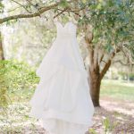 Strapless Ballgown Hayley Paige Wedding Dress on Hanger in Tree
