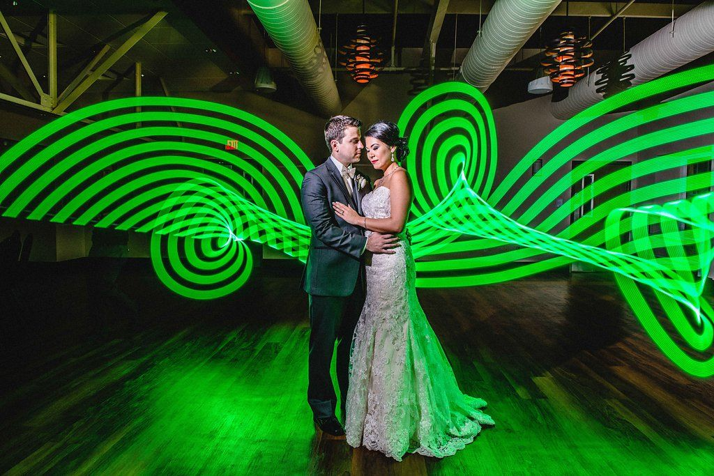 Creative Industrial Indoor Bride and Groom Portrait, Bride in Lace Column Strapless Dress, Groom in Gray Tuxedo, with Neon Green Light Art