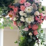 Wedding Ceremony Floral Arch with Peach ROses, White and Purple and Pink Flowers with Greenery