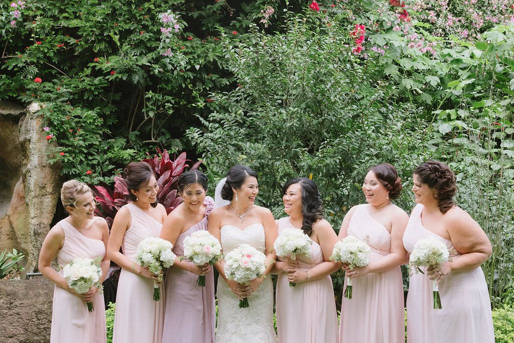 Outdoor Garden Wedding Bridal Party Portrait, Bridesmaids in One Shoulder Blush Pink Dresses, Bride in Strapless Lace Column Wedding Dress, with White and Blush Pink Rose Bouquets | St Pete Wedding Ceremony Venue The Sunken Gardens