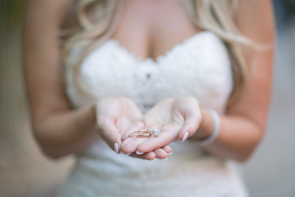 St. Pete bride holding wedding rings