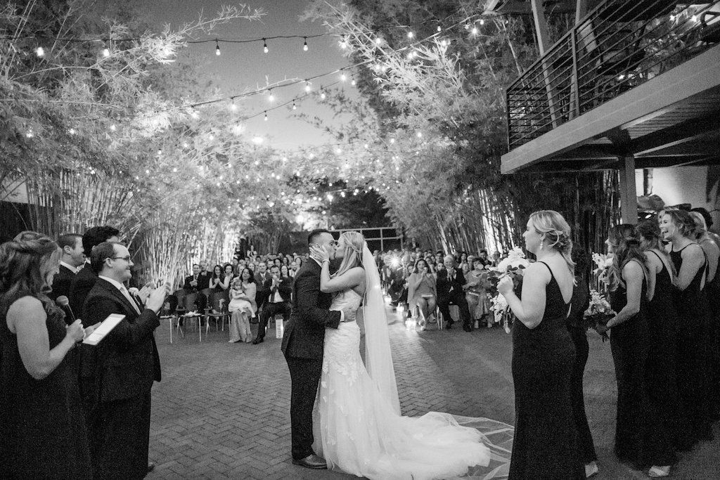 Nighttime ceremony under string lights at NOVA 535