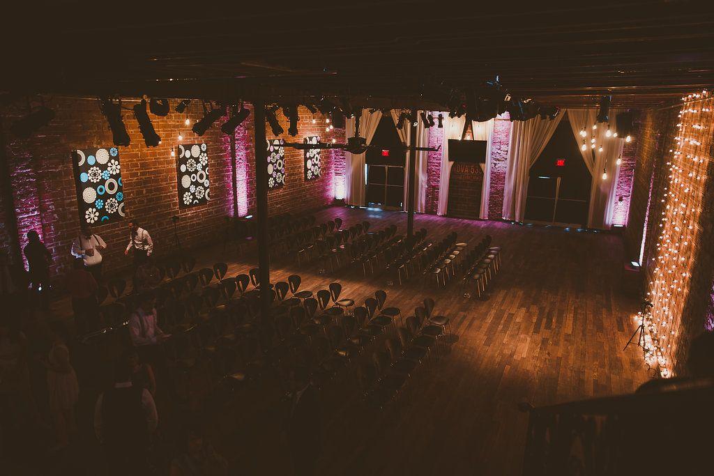 Nighttime wedding ceremony at modern St Pete wedding venue Nova 535 with string light ceremony backdrop