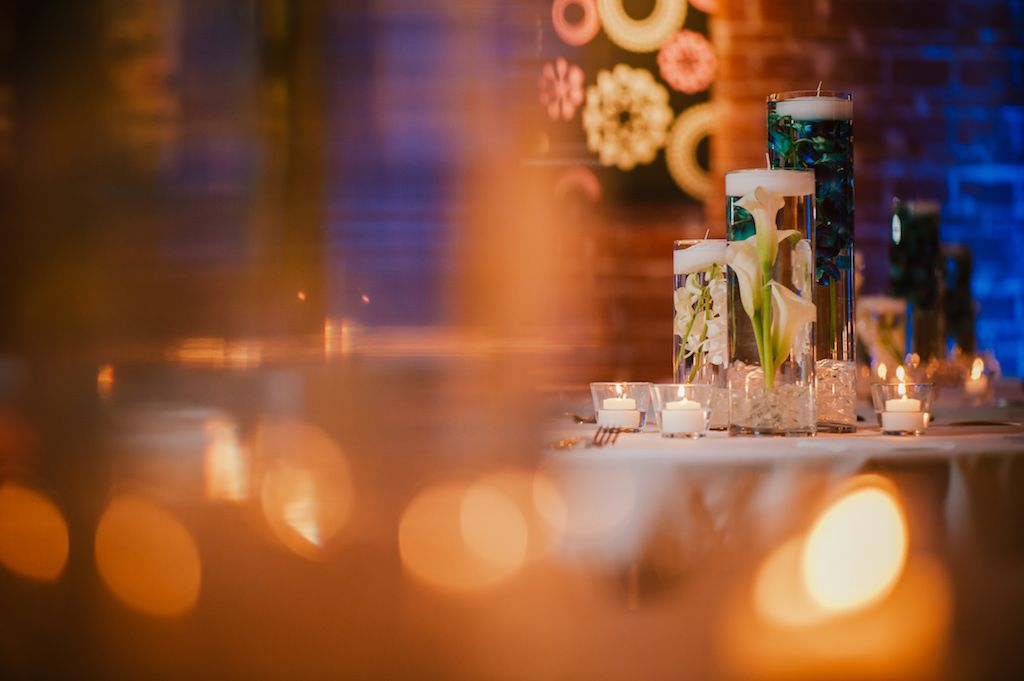 Blue and white floating candle and floral centerpieces