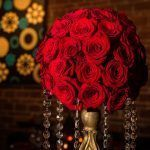 Round red rose centerpiece with hanging crystls
