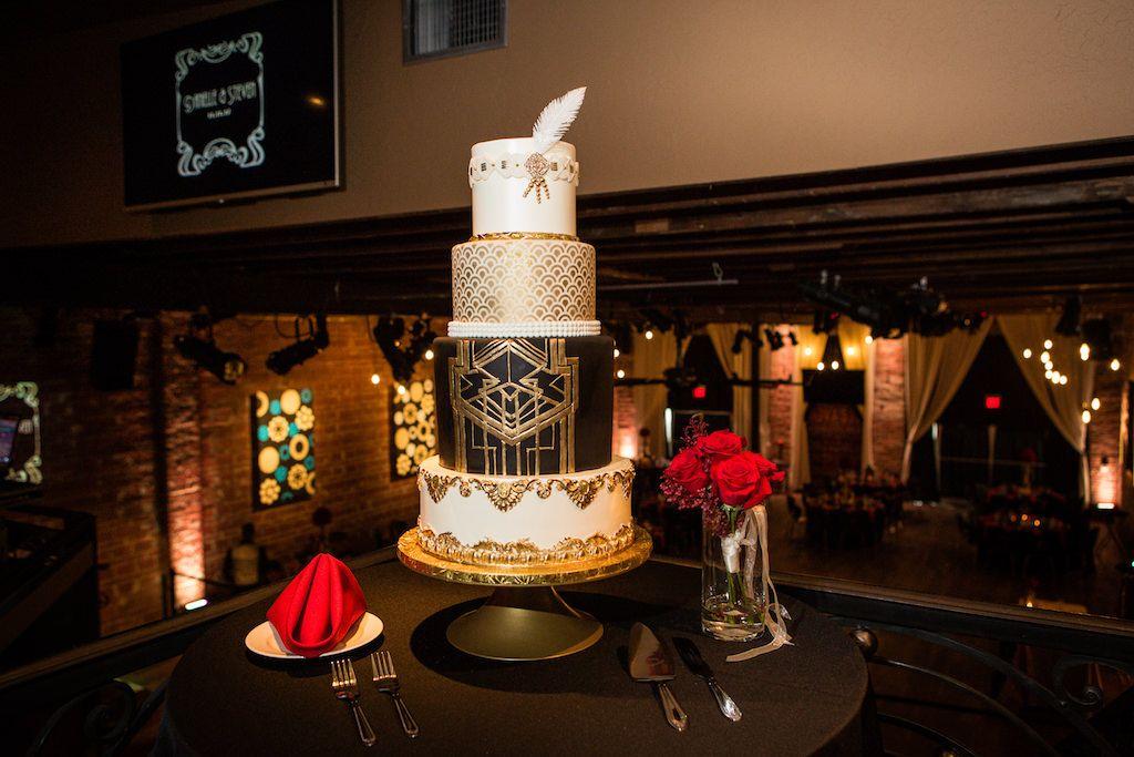 Glam black, white, and gold Art Deco wedding cake at St. Petersburg wedding at NOVA 535