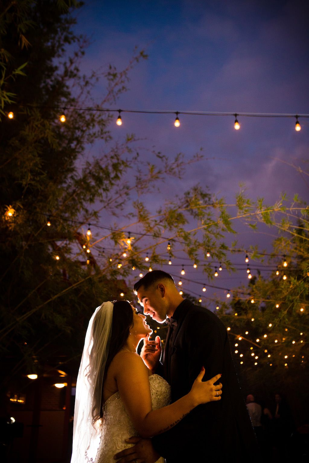 Bride and groom under string lights at St. Pete wedding venue NOVA 535