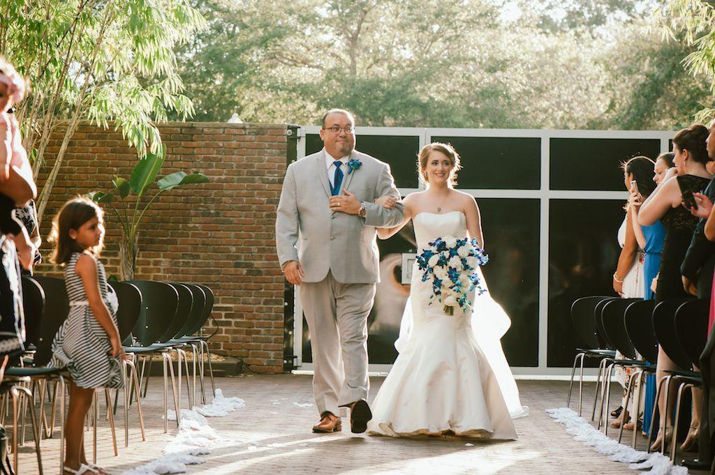 Bride walking down aisle for garden wedding at NOVA 535