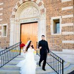 Bride and groom exiting ceremony at St Mary's Our Lady of Grace Church in St. Petersburg
