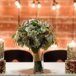 Greenery floating candle centerpiece at sweetheart table