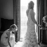 Bride in layered lace wedding dress