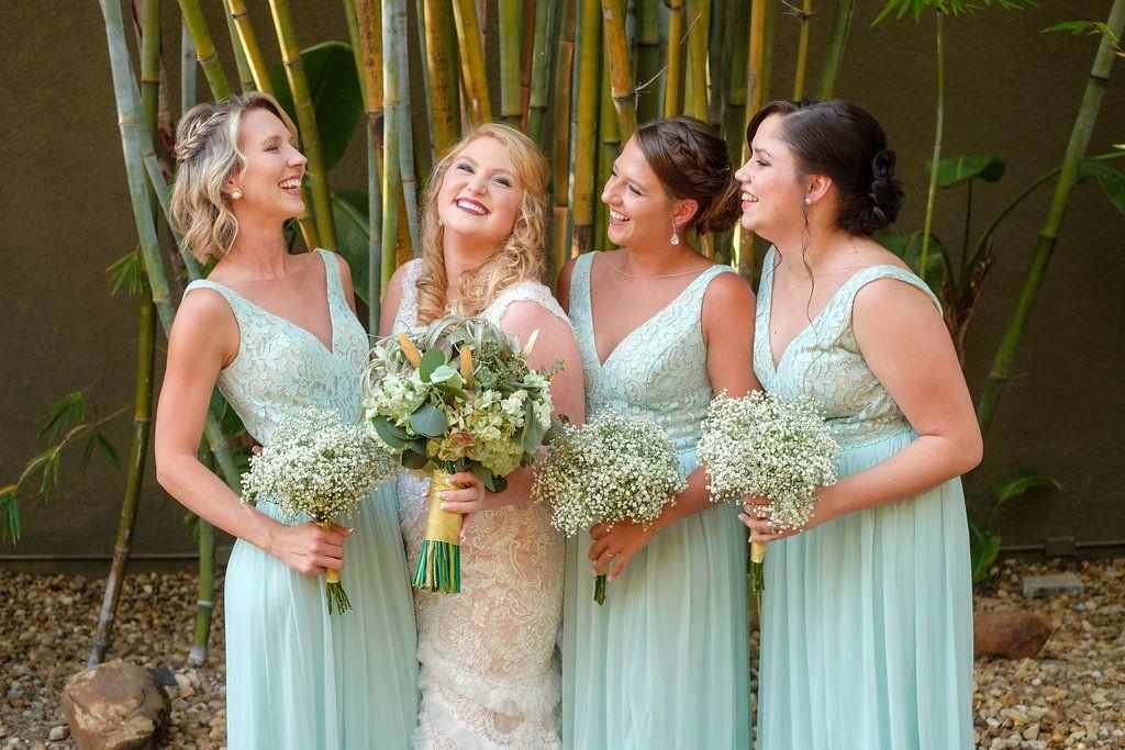 Bridesmaids in long v-neck seafoam green dresses at St. Pete wedding venue NOVA 535