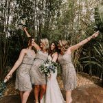 Bridesmaids in metallic lace dresses