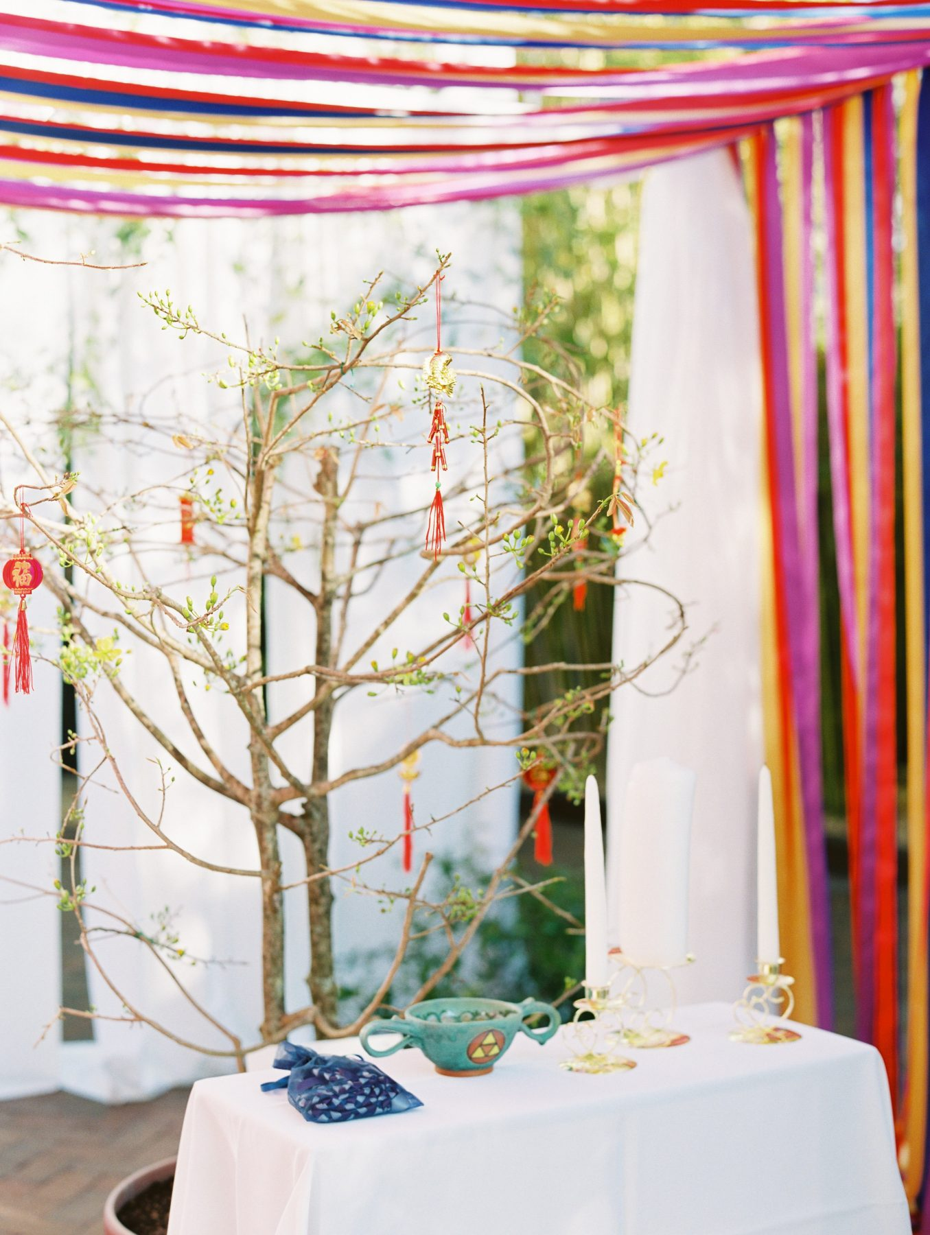Vietnamese wedding ceremony with colorful streamer backdrop | Multi-Cultural St Pete Wedding