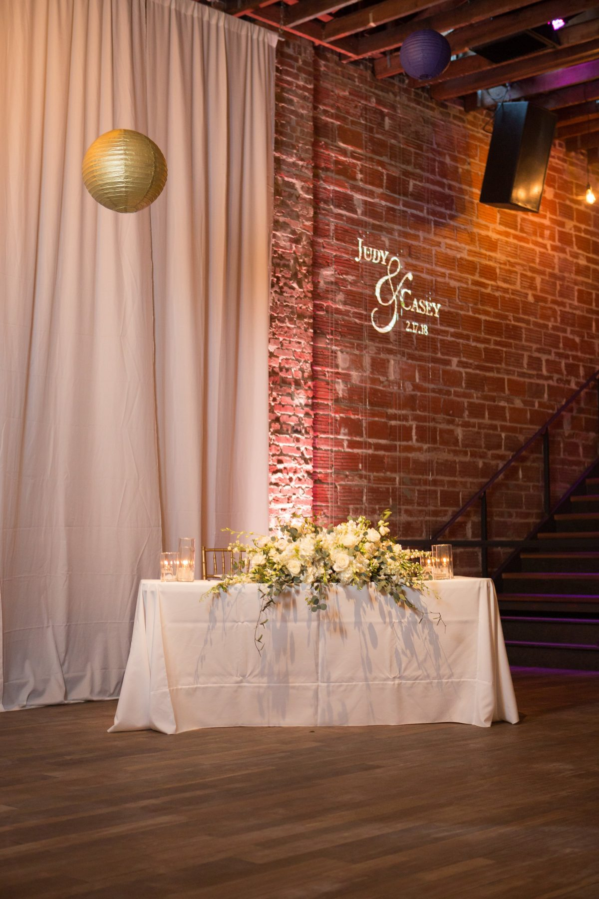 Sweetheart table with white florals at NOVA 535
