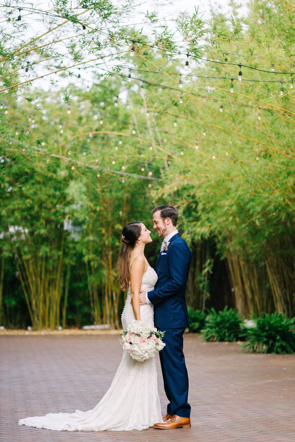 Modern, Florida Bride and Groom in Outdoor Bamboo Courtyard, | Downtown St. Pete Unique Wedding Venue NOVA 535