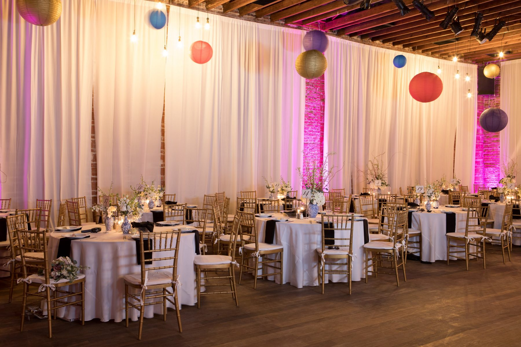 Reception at NOVA 535 with hanging Chinese lanterns and draping | Multi-Cultural St Pete Wedding