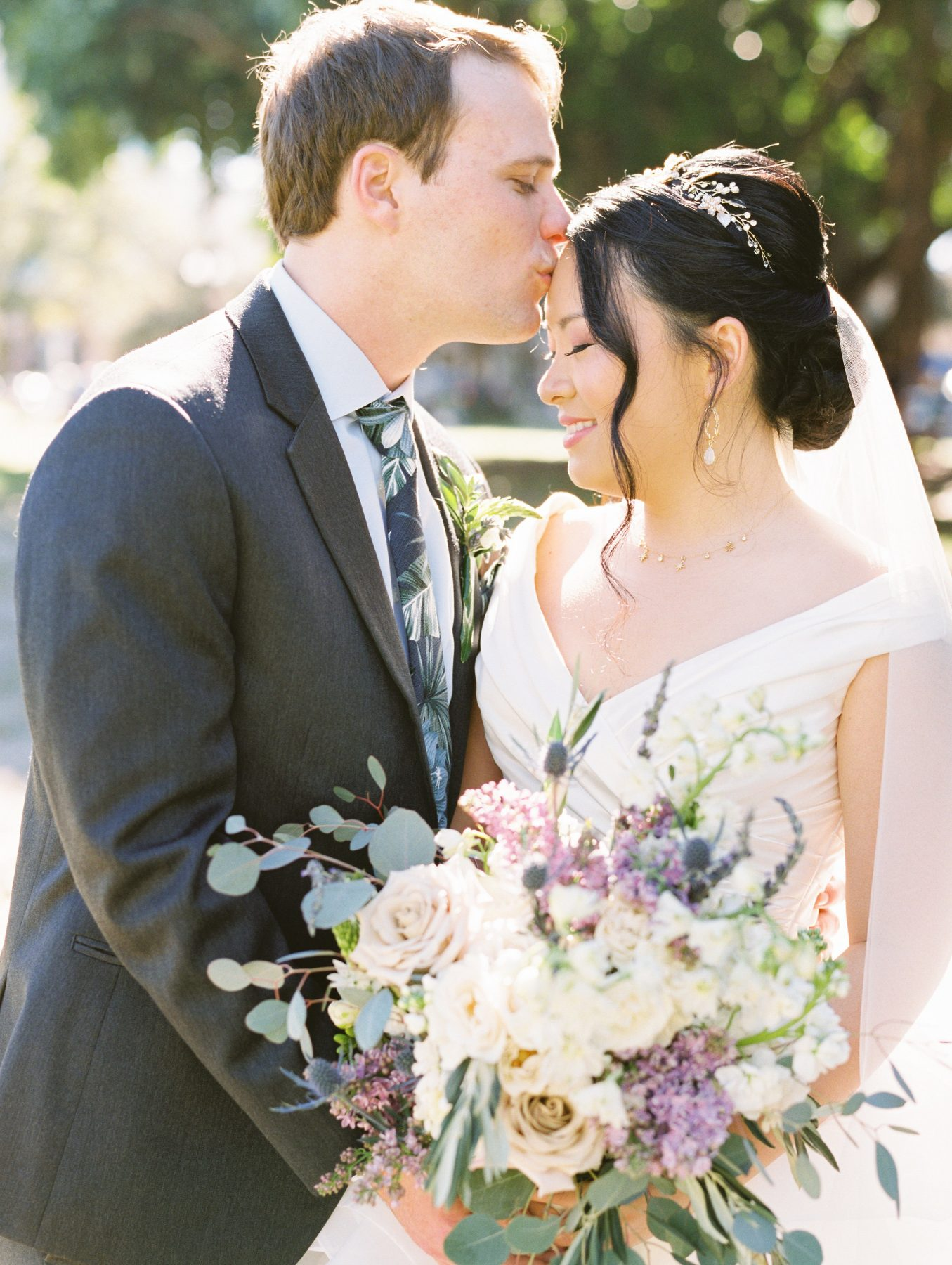 Bride with tiara with groom in floral print tie