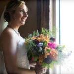 St. Pete bride with colorful bouquet in historic downtown st. Pete   Tampa Bay Unique Wedding Venue NOVA 535