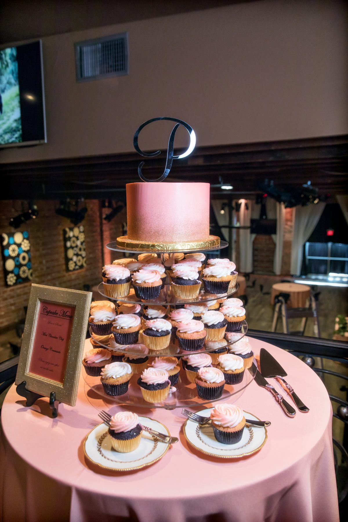Pink wedding cake and cupcake tower at unique St. Pete wedding Venue NOVA 535 in Tampa Bay