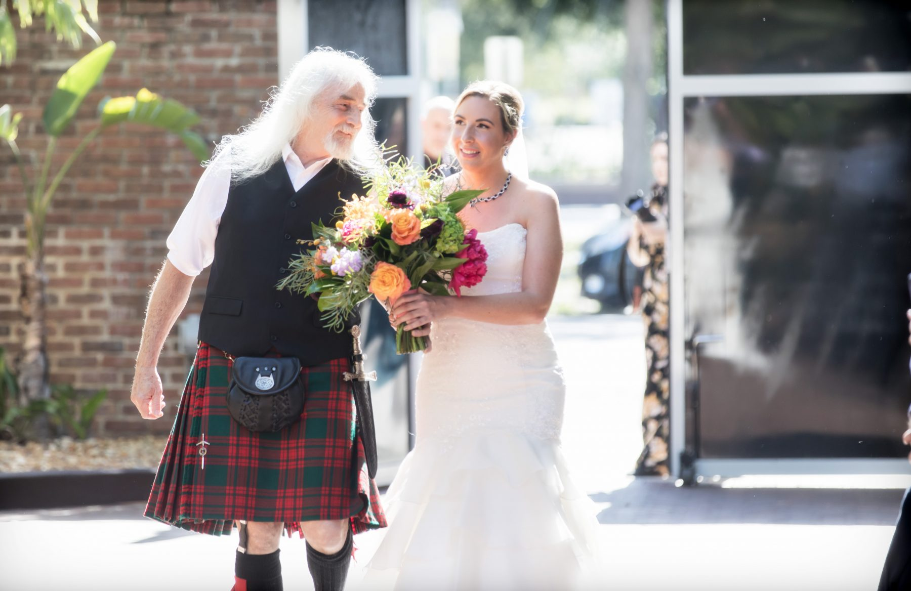 Florida Bride and Kilted father walking down the aisle during processional at ceremony in bamboo courtyard | Downtown St. Pete Premier Wedding Venue NOVA 535
