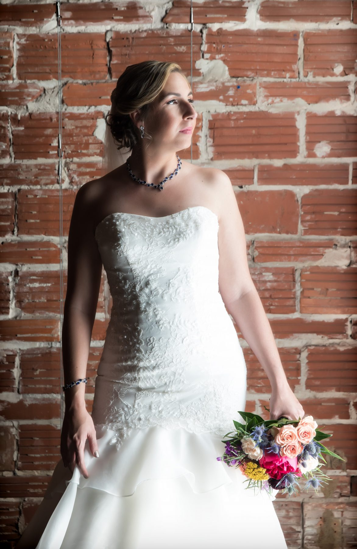 Vintage Florida Bride with Colorful Bridal Bouquet against Exposed Red Brick Wall | Downtown St. Pete Unique Wedding Venue NOVA 535
