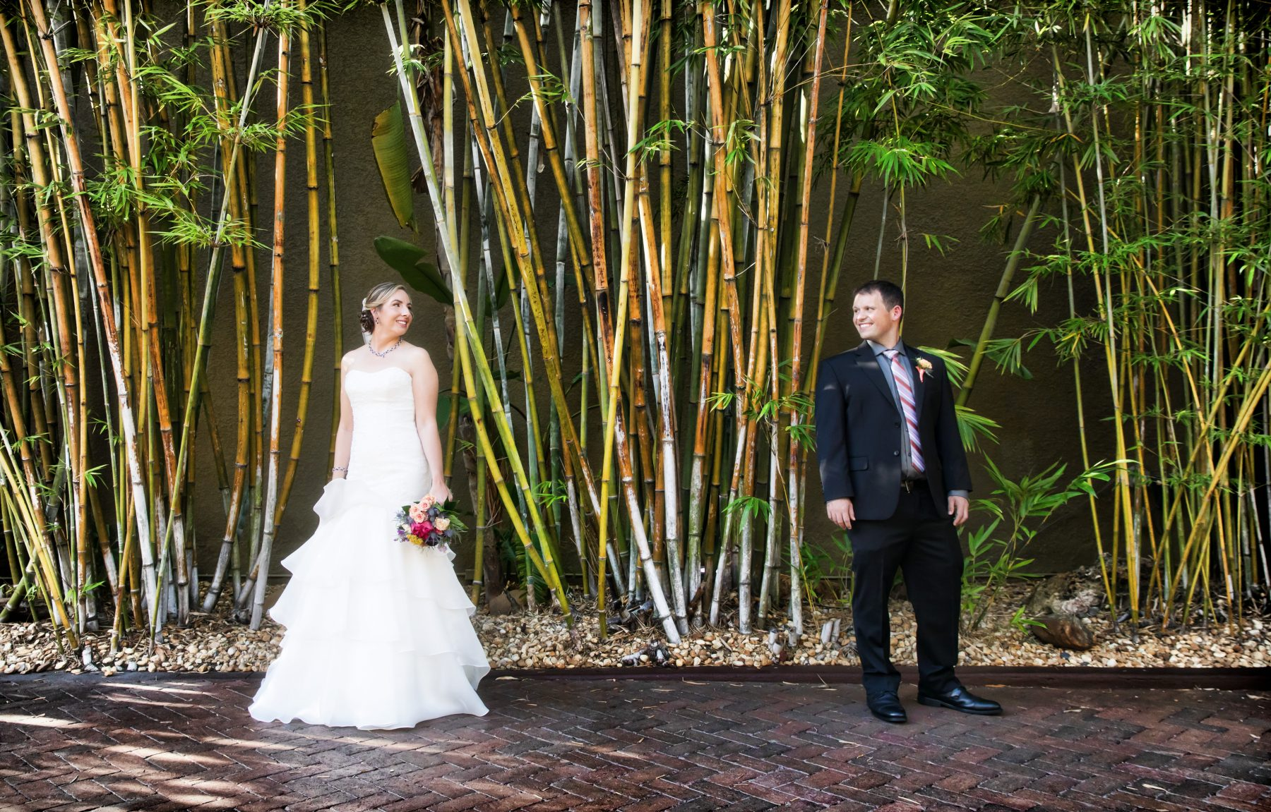 Florida Bride and Groom in romantic bamboo garden at Downtown St. Pete Unique Wedding Venue NOVA 535
