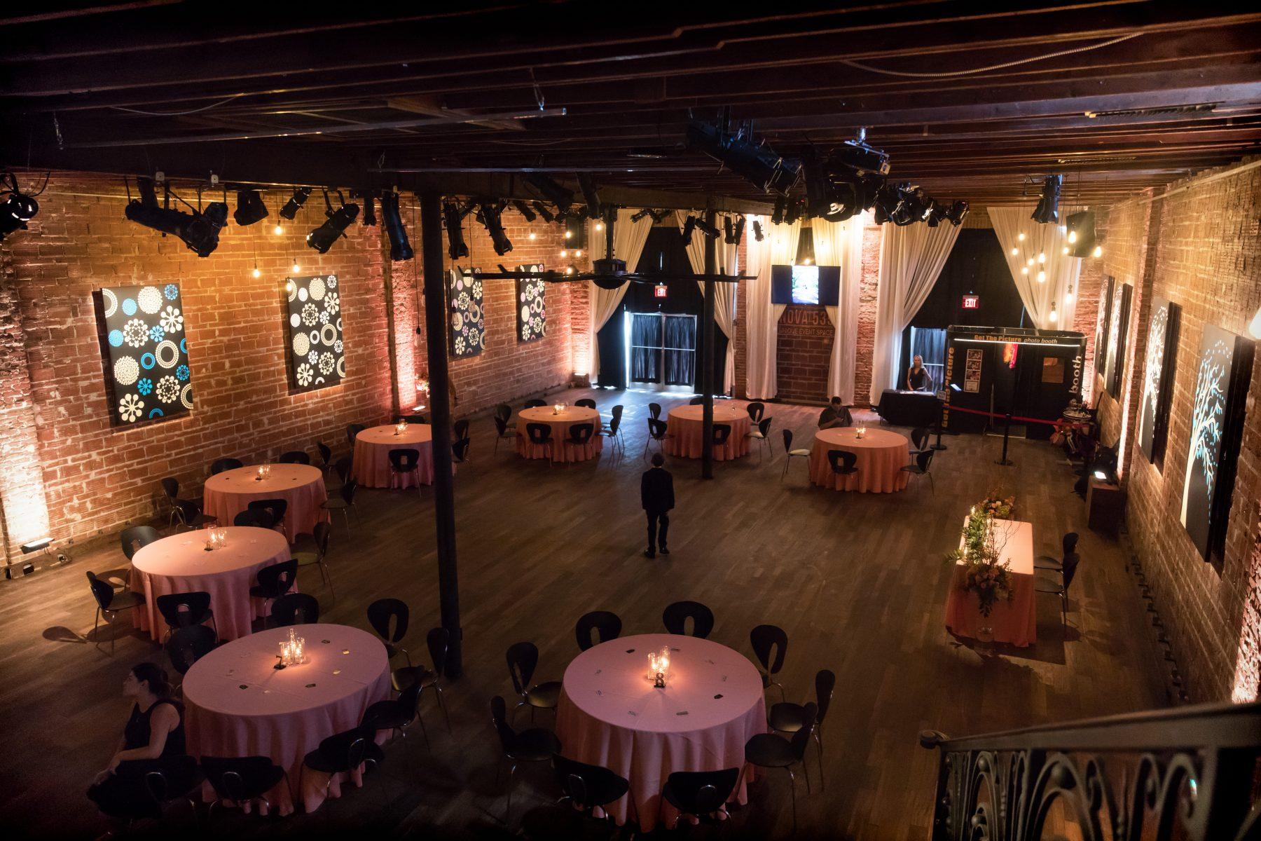Minimalist Mauve wedding decor at reception, exposed red brick wall at Historic St. Pete Wedding Venue NOVA 535