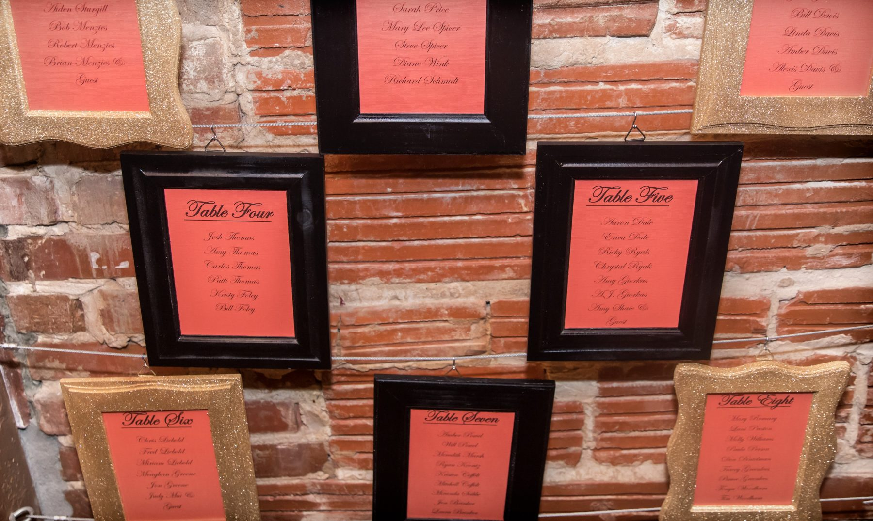 Unique Wedding Decor, Framed escort display against exposed red brick wall | Downtown St. Pete Wedding Venue NOVA 535