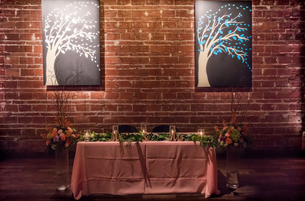 Vintage St Petersburg Wedding Sweetheart Table with Brick Wall Backdrop   Pink Mauve wedding reception at Industrial Downtown St. Pete Wedding Venue NOVA 535