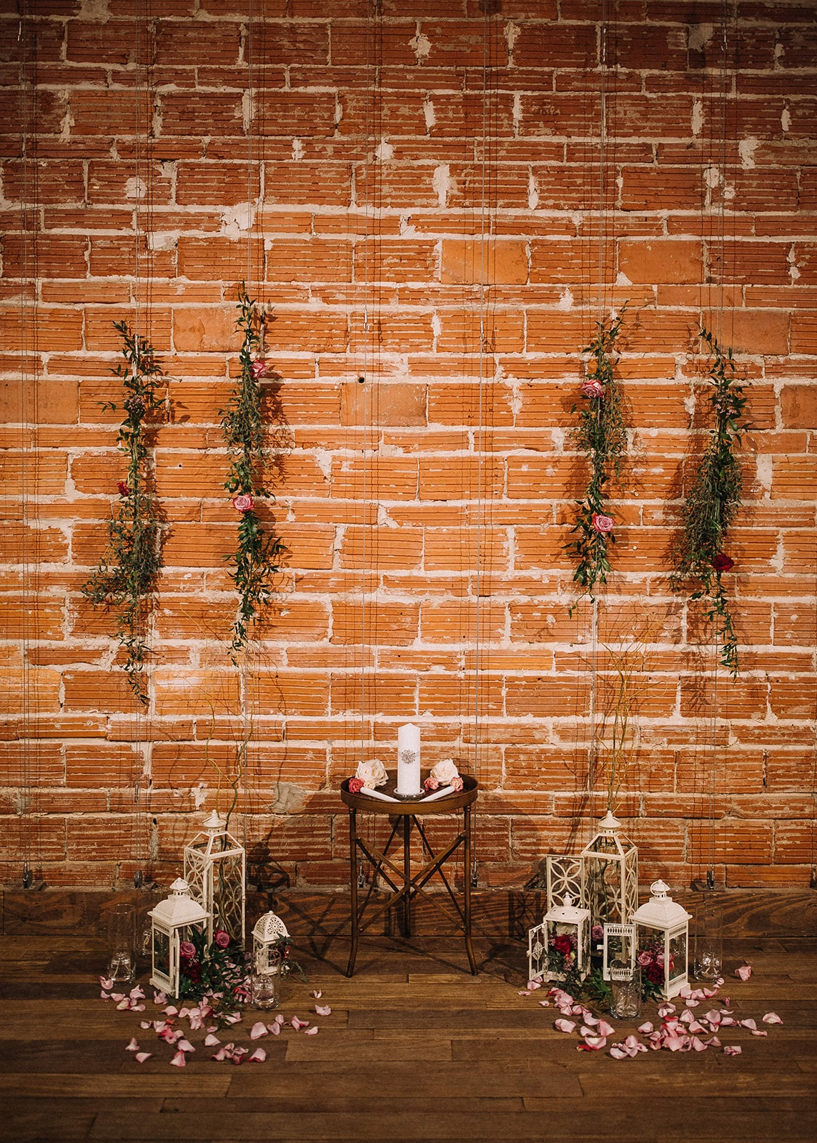 Urban Downtown St Pete Wedding with brick wall backdrop, lanterns, and greenery florals | Unique Tampa Bay Wedding Venue NOVA 535 Venue