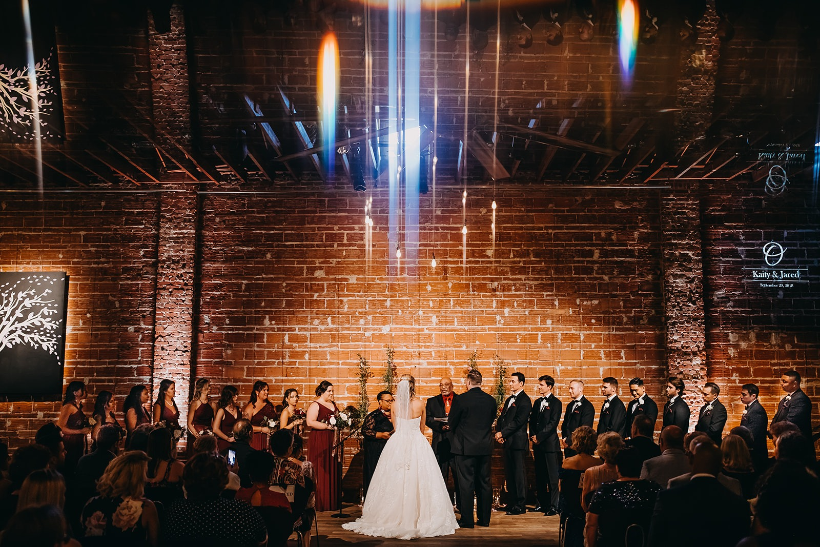Urban Downtown St Pete Wedding with exposed red brick wall ceremony backdrop and string lights | Tampa Bay Unique Wedding Venue NOVA 535