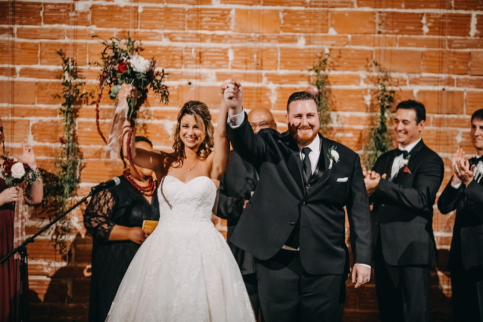 Urban Downtown St Pete Wedding with brick wall ceremony backdrop and string lights | Historic Tampa Bay wedding venue NOVA 535