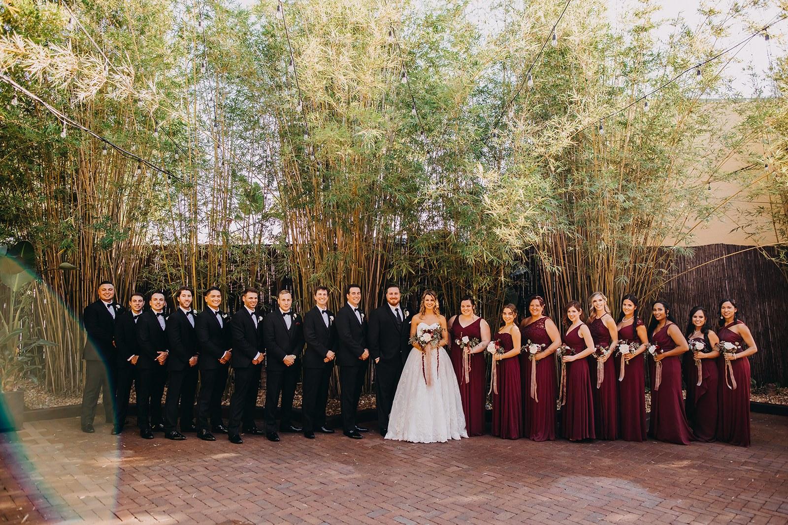Beautiful Dark Red Maroon Wedding Party in Florida Bamboo Courtyard | Downtown St. Pete Unique Wedding Venue NOVA 535