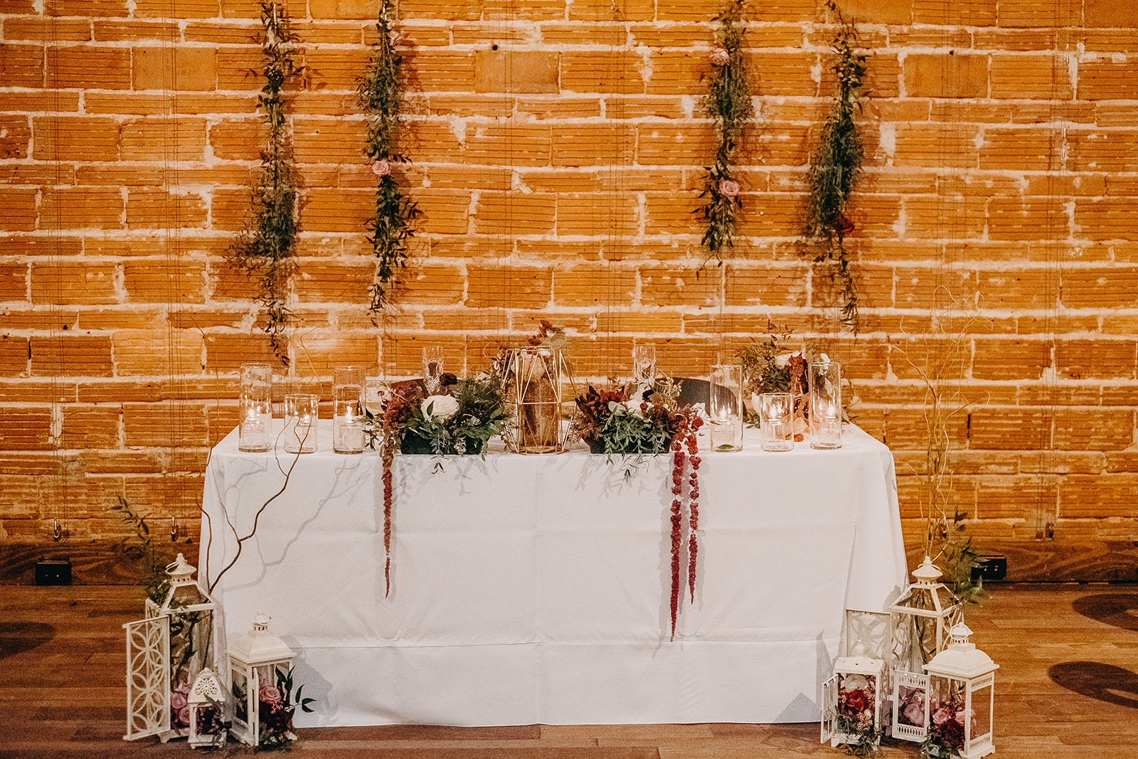 Romantic Sweetheart Table with Vintage Wedding Decor, Against Exposed Red Brick Wall Backdrop | St. Pete Unique Wedding Venue NOVA 535