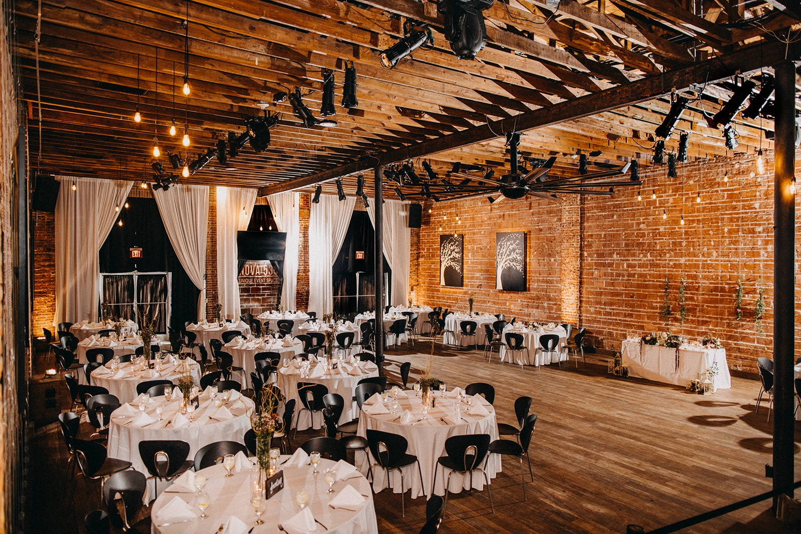 Urban Downtown St Pete Wedding reception with string lights, exposed red brick wall | Historic Florida Wedding Venue NOVA 535