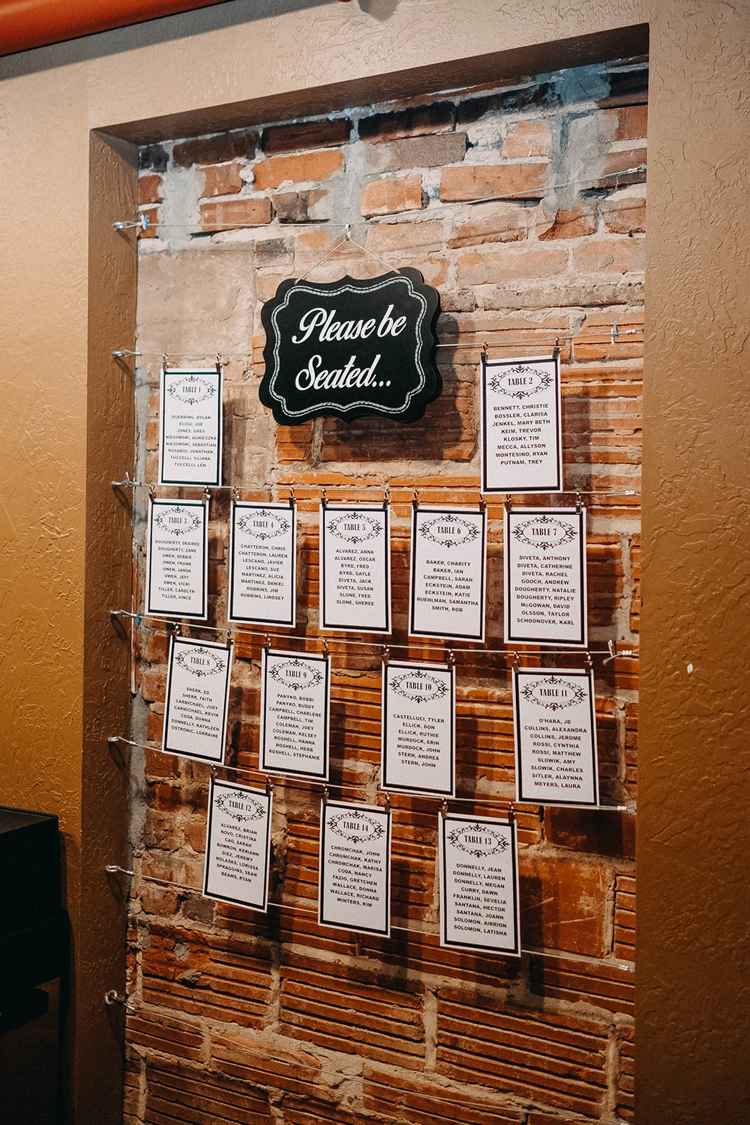 Downtown St. Pete Vintage Wedding Decor and Seating Chart against Exposed Red Brick Wall | Tampa Bay Historic Wedding Venue NOVA 535
