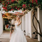 Bride in strapless sweetheart neckline wedding dress Industrial chic wedding decor with jam favors at Historic Wedding Venue NOVA 535 in Tampa Bay