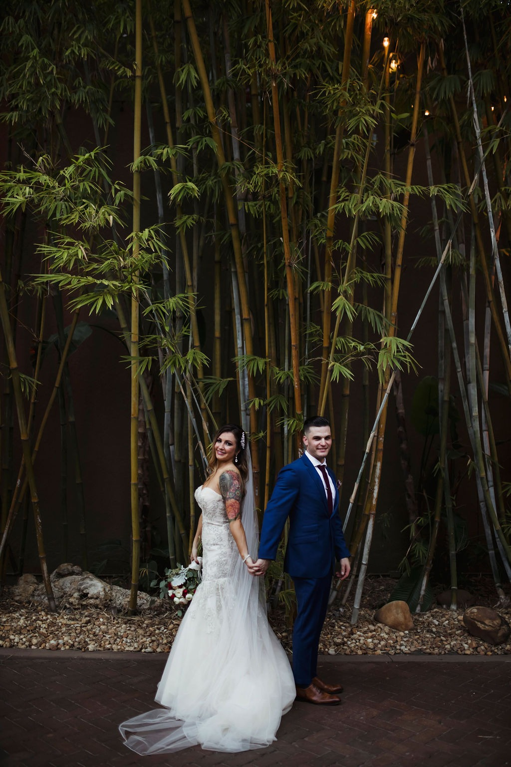 St. Pete wedding couple portrait at NOVA 535 in bamboo courtyard for Industrial-Chic St. Pete Wedding
