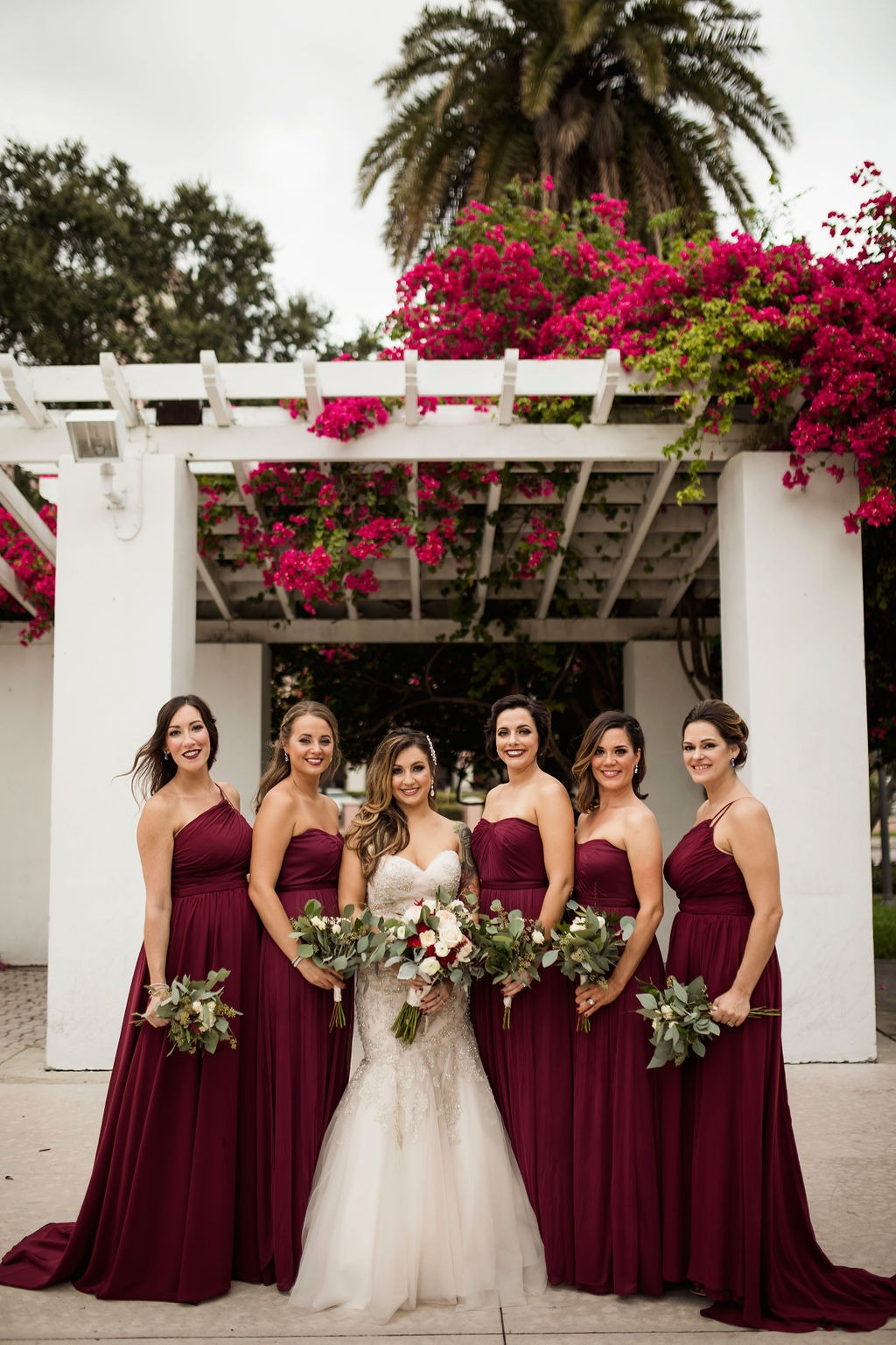 Bridesmaids in long burgundy gowns at St. Pete wedding
