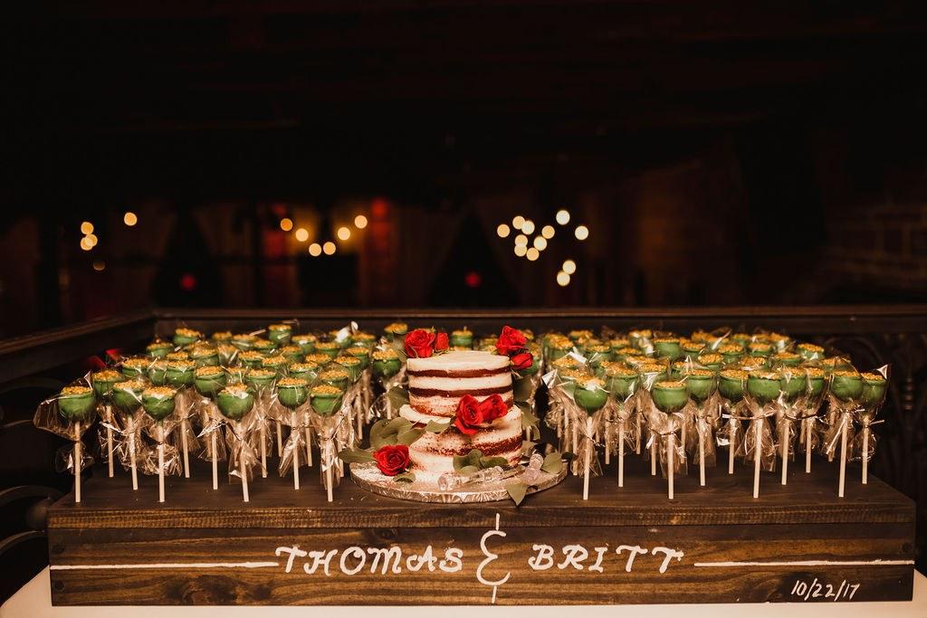 Naked red velvet wedding cake with pot of gold cake pops